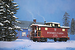 On a snowy winter evening in December, a PRR N5 caboose is at the Trainville station decked out in cheerful holiday lighting for Christmas.