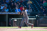 Salt River Rafters catcher Daulton Varsho (8), of the Arizona Diamondbacks organization, follows through on his swing during an Arizona Fall League game against the Surprise Saguaros on October 9, 2018 at Surprise Stadium in Surprise, Arizona. The Rafters defeated the Saguaros 10-8. (Zachary Lucy/Four Seam Images)