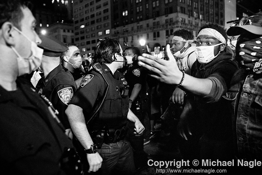 NEW YORK, NY — SEPTEMBER 24, 2020:  NYPD officers clash with demonstrators during protest against a Kentucky Grand Jury decision to not directly indict the officers involved in the shooting of Breonna Taylor, a 26 year-old EMT who was killed in her Louisville home by police on March 13th of this year, on September 24, 2020 in New York City.  Former police detective Brett Hankison faces three felony charges of wanton endangerment.  Photograph by Michael Nagle
