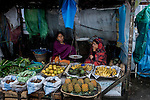 Khasi women running a fruit and vegetable shop in a bazzar in Cherapunji, nestled in East Khasi Hills- the wettest place on Earth. Khasi society is a matrilineal society in which men work in the field, do the domestic chores and take care of babies, whereas, women shoulder the responsibility of earning and running the household. Arindam Mukherjee