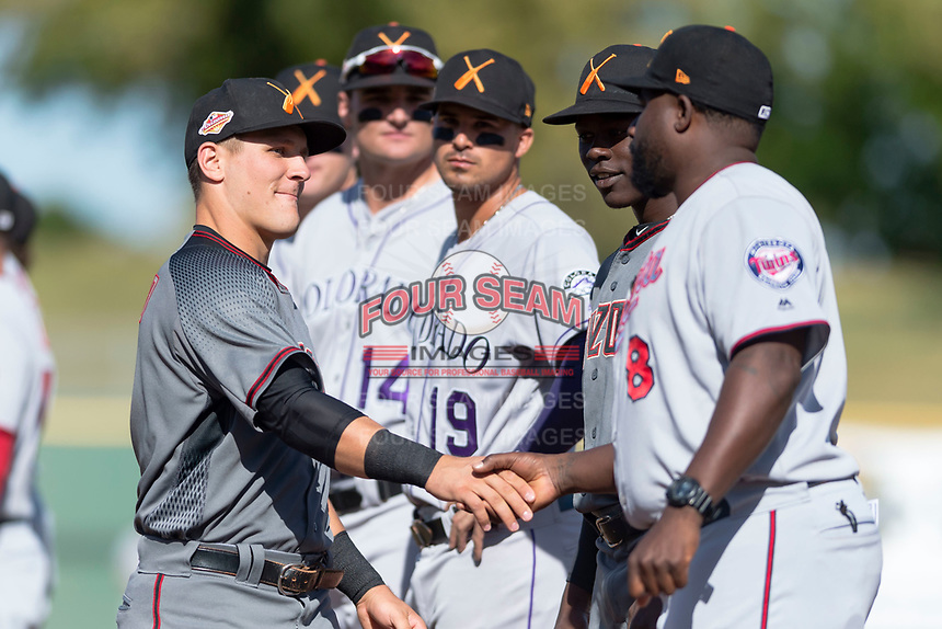 Salt River Rafters catcher Daulton Varsho (8), of the Arizona Diamondbacks organization, shakes hands with manager Tommy Watkins (8) during player introductions before the Arizona Fall League Championship game against the Peoria Javelinas at Scottsdale Stadium on November 17, 2018 in Scottsdale, Arizona. Peoria defeated Salt River 3-2 in extra innings. (Zachary Lucy/Four Seam Images)