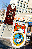 Official Fur Rondy sign on a sunny day at the Fur Rondy Festival, downtown Anchorage.