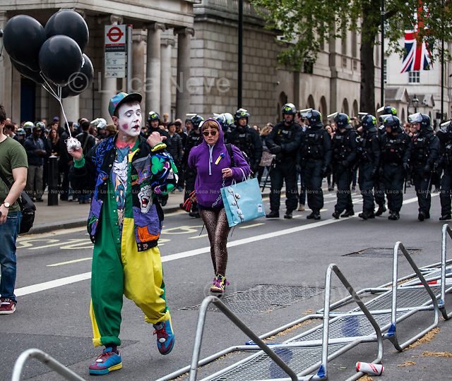 """"""" #ToriesOutNow - London's Protest Against Conservative Election Victory"""". <br /> <br /> For more pictures and info about this event please click here: http://bit.ly/1E0VKk9<br /> <br /> After 5 years of the Coalition Government (Conservatives and Liberal Democrats) led by the Conservative Party leader David Cameron, British people voted in favour of an end to the coalition arrangement. In fact, the Conservative Party gained 331 seats (36.9% - 11,334,920 votes) in the House of Commons which is a slender overall majority that allows them to form the next Government without the need of a coalition. The other results: Labour Party 232 seats (30,4% - 9,344,328 votes); Scottish National Party, SNP 56 seats (4,7% - 1,454,436 votes); Liberal Democrats 8 seats (7,9% - 2,415,888 votes); United Kingdom Independence Party, UKIP 1 seat (12.6% - 3,881,129 votes); Green Party 1 seat (3,8% - 1,157,613 votes); Democratic Unionist Party 8 seats (0,6% - 184,260 votes); Sinn Fein 4 seats (0,6% - 176,232 votes); Plaid Cymru 3 seats (0,6% - 181,694 votes); Social Democratic & Labour Party 3 seats (0,3% - 99,809 votes); Ulster Unionist Party 2 seats (0,2% - 114,935 votes); others 1 seat. <br /> The definitive turn out of the British General Election 2015 was 66.1% (<<The total size of the electorate will not be known until the tallies are collated individually by councils>> - source the Telegraph). During the day Ed Miliband (Labour leader), Nick Clegg (Liberal Democrats leader), Nigel Farage (UKIP leader) all resigned from their positions as leaders of their respective parties.<br /> <br /> For more information please click here: http://bit.ly/1H3TRrA"""