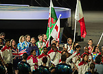 Wales Gareth Evans carries in the Welsh flag during the closing ceremony<br /> <br /> *This image must be credited to Ian Cook Sportingwales and can only be used in conjunction with this event only*<br /> <br /> 21st Commonwealth Games - Closing ceremony- Day 11 - 15\04\2018 - Carrara Stadium - Gold Coast City - Australia