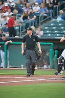 Umpire Brian Walsh handles the calls behind the plate during the game between the Salt Lake Bees and the Reno Aces at Smith's Ballpark on August 24, 2021 in Salt Lake City, Utah. The Aces defeated the Bees 6-5. (Stephen Smith/Four Seam Images)