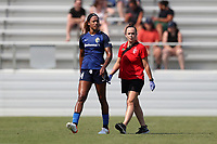 CARY, NC - SEPTEMBER 12: Jessica McDonald #14 of the North Carolina Courage is helped off of the field by team trainer Jane Sweeney during a game between Portland Thorns FC and North Carolina Courage at Sahlen's Stadium at WakeMed Soccer Park on September 12, 2021 in Cary, North Carolina.