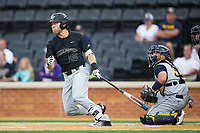 Logan Harvey (15) of the Wake Forest Demon Deacons follows through on his swing against the West Virginia Mountaineers in Game Six of the Winston-Salem Regional in the 2017 College World Series at David F. Couch Ballpark on June 4, 2017 in Winston-Salem, North Carolina.  The Demon Deacons defeated the Mountaineers 12-8.  (Brian Westerholt/Four Seam Images)
