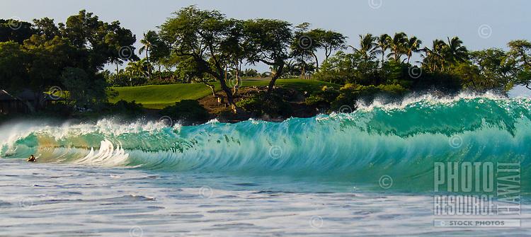 A bodysurfer takes a picture in the barrel of a wave at Kauna'oa Bay near Mauna Kea Hotel, Big Island.