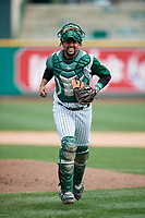 Fort Wayne TinCaps catcher Webster Rivas (8) jogs from the mound during a game against the Wisconsin Timber Rattlers on May 10, 2017 at Parkview Field in Fort Wayne, Indiana.  Fort Wayne defeated Wisconsin 3-2.  (Mike Janes/Four Seam Images)