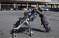Pictured: A young boy pushes along his younger brother in his push chair Monday 07 March 2016<br /> Re: Migrants have been gathering at the port of Piraeus, near Athens, Greece.
