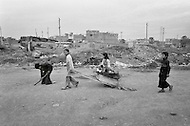Children working in garbage dump. Bogota, Colombia - Child labor as seen around the world between 1979 and 1980 – Photographer Jean Pierre Laffont, touched by the suffering of child workers, chronicled their plight in 12 countries over the course of one year.  Laffont was awarded The World Press Award and Madeline Ross Award among many others for his work.