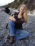 Deddeda Stemler with her camera on the beach in Victoria, British Columbia, Canada.