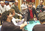 Barney Boatman loses a hand and finsishes 18th in the tournament.  He was beaten by David Levi, who he shakes hands with.