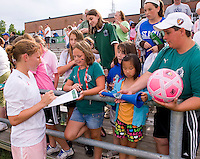 St Louis Athletica midfielder Lori Chalupny (17) signs autographs for fans after a WPS match at Anheuser-Busch Soccer Park, in St. Louis, MO, June 7, 2009. Athletica won the match 1-0.