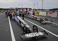 Mar. 17, 2013; Gainesville, FL, USA; NHRA crew members for top fuel dragster driver Antron Brown (left) alongside Spencer Massey in the staging lanes during the Gatornationals at Auto-Plus Raceway at Gainesville. Mandatory Credit: Mark J. Rebilas-
