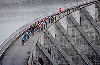 peloton crossing the Barrage de Roselend<br /> <br /> 73rd Critérium du Dauphiné 2021 (2.UWT)<br /> Stage 7 from Saint-Martin-le-Vinoux to La Plagne (171km)<br /> <br /> ©kramon
