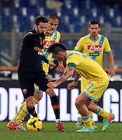 Calcio, semifinale di andata di Coppa Italia: Roma vs Napoli. Roma, stadio Olimpico, 5 febbraio 2014.<br /> AS Roma midfielder Miralem Pjanic, of Bosnia, left, is challenged by Napoli midfielders Gokhan Inler, of Switzerland, center, and Marek Hamsik, of Slovakia, during the Italian Cup first leg semifinal football match between AS Roma and Napoli at Rome's Olympic stadium, 5 FeBruary 2014.<br /> UPDATE IMAGES PRESS/Riccardo De Luca
