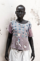 Africa, Sudan, Magwi County, Nimule, Southern Sudan - the young girl picture here witnessed the killing of her father and saw the her mother raped and abducted by the Lord's Resistance army. The rebels also abducted her and killed all of her brother and sisters. She escaped and now stays at and orphange compound in Nimule. December 2005 © Stephen Blake Farrington