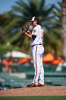 Baltimore Orioles relief pitcher Hunter Harvey (56) looks in for the sign during a Grapefruit League Spring Training game against the Tampa Bay Rays on March 1, 2019 at Ed Smith Stadium in Sarasota, Florida.  Rays defeated the Orioles 10-5.  (Mike Janes/Four Seam Images)