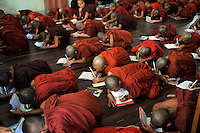 "Monks learn prayers in a monastery, Mandalay, Burma November 08.  Monks in this largely Buddhist country have to beg from villagers in order to feed themselves and in this city the government hand-outs stopped after the ""saffron revolution"" of October 2007.<br />