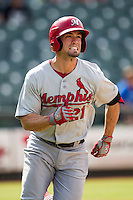 Memphis Redbirds outfielder Randal Grichuk (21) runs to first base during the first game of a Pacific Coast League doubleheader against the Round Rock Express on August 3, 2014 at the Dell Diamond in Round Rock, Texas. The Redbirds defeated the Express 4-0. (Andrew Woolley/Four Seam Images)