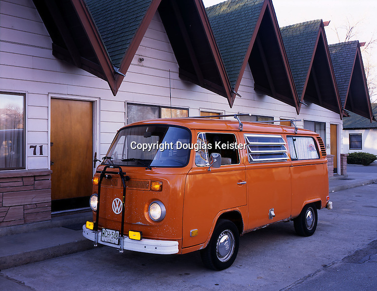 Volkswagen owners are a dedicated breed, often nurturing their aging vans far beyond their projected life. Such is the case with this orange 1973 Kombi with a quarter million miles, many of them logged on dusty back roads of Utah and Nevada. Miraculously the paint is original, and the only maintenance to its lustrous finish is an occasional waxing and buffing. The Kombi was retrofitted with the Campmobile package, which includes a sink, dining table, bench seat that converts into a bed, louvered side windows with curtains, child's cot that fits across the flight deck, closet, storage cabinets, and rear bug screen. Volkswagens have a habit of appearing in motion pictures, most notably in Disney's Herbie films. This orange Kombi had a cameo role in another Disney film, Meet the Deedles. The van is owned by Salt Lake City–based author/photographer Richard Menzies. Photographed at the Scott Shady Court, Winnemucca, Nevada.