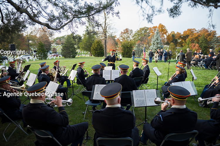 """U.S. Army Band, """"Pershing's Own"""", performs at the Military Order of the World Wars memorial service on Veterans Day at the gravesite of General of the Armies John Pershing in Section 34 of Arlington National Cemetery, Arlington, Virginia, Nov. 11, 2017.  Representatives from over a dozen foreign countries laid wreaths at Pershing's gravesite.  (U.S. Army photo by Elizabeth Fraser / Arlington National Cemetery / released)"""