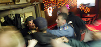 "10/22/03 crab NWS::  A patron is shoved out the door after a fight breaks out in the Elbow Room in Unalaska, AK.  Opened in 1966 by Larry Shaishnikoff and his partner the Elbow Room has garnered a reputation as one of the most dangerous bars in America.  Today however, it has toned down as fishing seasons in the Bering Sea and Bristol Bay have been shortened and new bars have opened in this remote port of Dutch Harbor, AK.  Now at age 72, Shaishnikoff is ready to retire and plans to put the bar up for sale at the first of the year.  Built in 1941 by the US military during WWII, the building first served as a grocery store.  It later became a bar before it was abandoned.  In 1966 Shaishnikoff bought the abandoned structure for $800 and made up to a million dollars in some years.  ""This place has calmed down quite a bit."" he says."