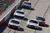 #18: Denny Hamlin, Joe Gibbs Racing, Toyota Camry SportClips and #98: Kevin Harvick, Biagi-DenBeste Racing, Ford Mustang Hunt Brothers Pizza Throwback