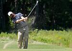 1 September 2008: Lucas Glover hits an approach shot at the Deutsche Bank Golf Championship in Norton, Massachusetts.