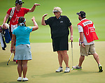CHON BURI, THAILAND - FEBRUARY 17:  Laura Davis of England and Christina Kim of USA laugh walks on the 18th hole during day two of the LPGA Thailand at Siam Country Club on February 17, 2012 in Chon Buri, Thailand.  Photo by Victor Fraile / The Power of Sport Images