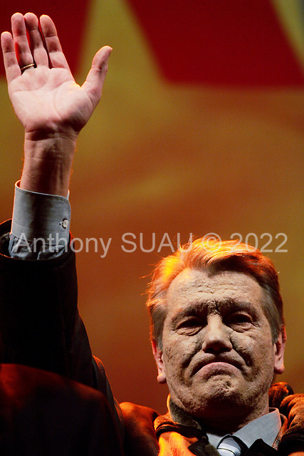"Kiev, Ukraine.December 28, 2004..Opposition candidate Viktor Yushchenko takes center stage on Maidan Independence Square as thousands of Orange flag waving supporters rally to his side. Election polls show him as a clear winner however he has not yet been declared the winner nor has his opponent refuses to admit defeat...He is joined on stage by his wife Kathy, his son Andrey and his political partner Yulia Timoshenko. ..The first round of voting was considered fraudulent when the ruling president Viktor Yahukovich won and the opposition candidate Viktor Yushchenko lost. ..Several hundred thousand Ukrainians took to the streets of Kiev and held daily rallies on Maidan Independence Square. The protests lasted nearly a month before the first vote was declared invalid and a new round of elections held on December 26, 2004. ..The demonstrations would come to be known as the ""Orange Revolution"" after the color of the opposition party."