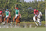 WELLINGTON, FL - FEBRUARY 19: Gillian Johnston of Coca Cola takes control of the ball, while being pursued by Facundo Obregon and Costi Caset of Tonkawa as Coca Cola 9 defeats Tonkawa 8 in overtime with a Golden Goal on a Penalty 2 by Julio Arellano, in the William Ylvisaker Cup Final, at the International Polo Club, Palm Beach on February 19, 2017 in Wellington, Florida. (Photo by Liz Lamont/Eclipse Sportswire/Getty Images)