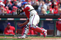 Philadelphia Phillies catcher Carlos Ruiz #51 fields a bunt during their home opener against the Miami Marlins at Citizens Bank Park on April 9, 2012 in Philadelphia, Pennsylvania.  Miami defeated Philadelphia 6-2.  (Mike Janes/Four Seam Images)