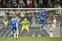 30th September 2021; Marshall Józef Piłsudski's Municipal Stadium, Warsaw, Poland: Europa League fooball, Legia Warsaw versus Leicester City;  CEZARY MISZTA watches the header from KIEMAN DEWSBURY-HALL
