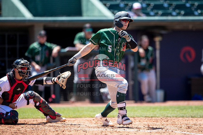 Great Lakes Loons catcher Ryan January (5) follows through on his swing on May 30, 2021 against the Lansing Lugnuts at Jackson Field in Lansing, Michigan. (Andrew Woolley/Four Seam Images)