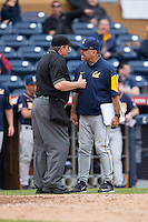 California Golden Bears head coach David Esquer argues a call with home plate umpire Reid Churchhill during the game against the Duke Blue Devils at Durham Bulls Athletic Park on February 20, 2016 in Durham, North Carolina.  The Blue Devils defeated the Golden Bears 6-5 in 10 innings.  (Brian Westerholt/Four Seam Images)