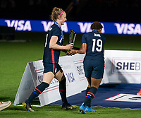 ORLANDO, FL - FEBRUARY 24: Becky Sauerbrunn #4 and Crystal Dunn #19 of the USWNT carry the SheBelieves Cup trophy after a game between Argentina and USWNT at Exploria Stadium on February 24, 2021 in Orlando, Florida.