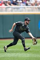 Vanderbilt Commodores outfielder Stephen Scott (19) attempts to make a running catch during Game 8 of the NCAA College World Series against the Mississippi State Bulldogs on June 19, 2019 at TD Ameritrade Park in Omaha, Nebraska. Vanderbilt defeated Mississippi State 6-3. (Andrew Woolley/Four Seam Images)