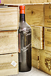 Big Wine Bottle with inscription and Open Wooden Cases of Wine.  White wine and red wine.  No brand names visible.