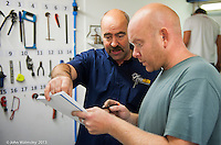 Plumbing instructor with trainee, Able Skills training centre, Dartford, Kent.