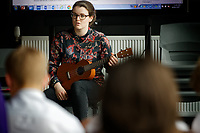 Pictured: Tic Ashfield plays some of the music arranged on her guitar to Year 9 and 10 pupils as they rehearse Wales National Opera's Rhondda Rips It UP at of John Frost School in Newport, Wales, UK. Thursday 11 May 2018<br /> Re: Welsh National Opera is creating a new musical hall-style all female piece for the summer called Rhondda Rips It Up. It's about the life of suffragette Lady Rhondda with songs inspired by suffragette slogans. Opera opening next month in Newport, south Wales, where Lady Rhondda blew up a postbox with a home-made bomb and went to jail for.