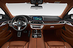 Stock photo of straight dashboard view of a 2018 BMW 7 Series M Sport 4 Door Sedan