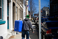 A man carries a cooler toward the St. Patrick's Day Parade in South Boston, Massachusetts.