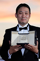 CANNES, FRANCE - JULY 17: Ryusuke Hamaguchi poses with the 'Best Screenplay Award' for 'Drive my Car' during the 74th annual Cannes Film Festival on July 17, 2021 in Cannes, France. <br /> CAP/GOL<br /> ©GOL/Capital Pictures