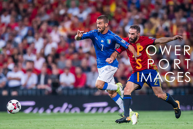 Leonardo Spinazzola (L) of Italy fights for the ball with Daniel Carvajal (R) of Spain during their 2018 FIFA World Cup Russia Final Qualification Round 1 Group G match between Spain and Italy on 02 September 2017, at Santiago Bernabeu Stadium, in Madrid, Spain. Photo by Diego Gonzalez / Power Sport Images