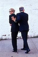 Man protecting woman