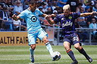 ST PAUL, MN - JULY 18: Kelyn Rowe #22 of the Seattle Sounders FC and Franco Fragapane #7 of Minnesota United FC battle during a game between Seattle Sounders FC and Minnesota United FC at Allianz Field on July 18, 2021 in St Paul, Minnesota.