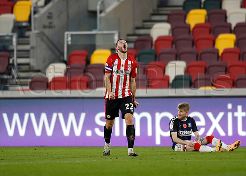 7th November 2020; Brentford Community Stadium, London, England; English Football League Championship Football, Brentford FC versus Middlesbrough; Henrik Dalsgaard of Brentford screaming in anger after conceding another free kick to Middlesbrough after fouling Hayden Coulson of Middlesbrough