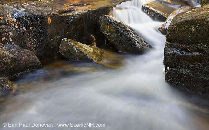 A small cascade on Black Brook in Carroll, New Hampshire during the autumn months.